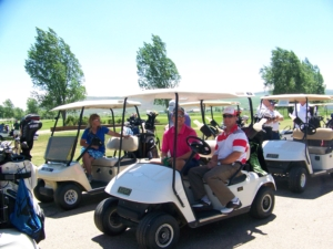 Memorial Regional Health Golf Outing Golf Cart Photo showing players smiling while riding around in the golf carts