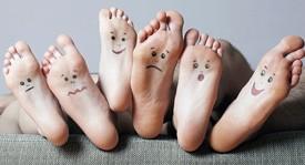 Feet with faces written in pen